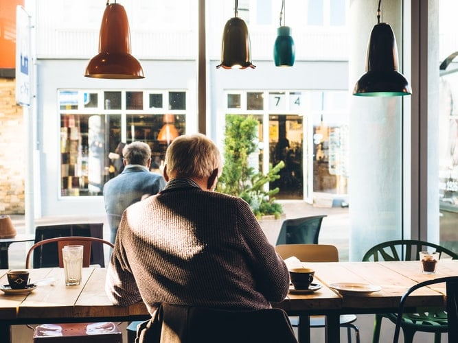 Man sits inside coffee shop