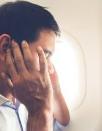 Man experiences ear pressure on plane.